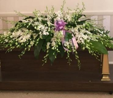 All White Orchid Casket Spray